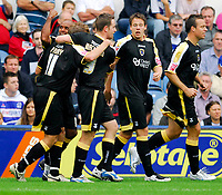 Photo: Leigh Quinnell.<br /> Queens Park Rangers v Cardiff City. Coca Cola Championship. 18/08/2007. Cardiffs Trevor Sinclair helps  Paul Parry celebrate his goal.