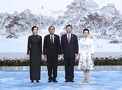 (170904) -- XIAMEN, Sept. 4, 2017 (Xinhua) -- Chinese President Xi Jinping and his wife Peng Liyuan welcome Thai Prime Minister Prayut Chan-o-cha and his wife before a banquet for those attending the ninth BRICS summit and the Dialogue of Emerging Market and Developing Countries in Xiamen, southeast China's Fujian Province, Sept. 4, 2017. (Xinhua/Ma Zhancheng) (mcg) (Photo by Xinhua/Sipa USA)