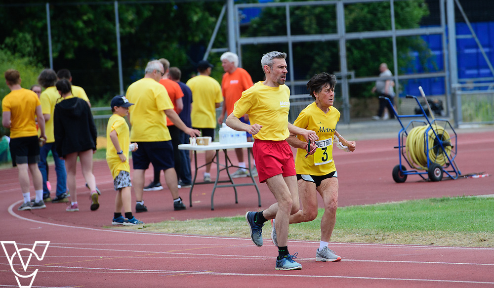 Event: 5000 meter relay<br /> Competitors, from left: Janice Newman<br /> <br /> Metro Blind Sport's 42nd Athletics Open, held at Mile End Stadium, Tower Hamlets, London.<br /> <br /> Picture: Chris Vaughan Photography for Metro Blind Sports<br /> Date: June 16, 2018