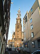 A view down Bloemstraat looking at the steeple of Westerkerk; Amsterdam, Netherlands.