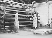 Two female employees are assembling finished cardboard boards in a factory, Finland 1930s