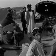 Jul 13, 2009 - Zhari District, Kandahar Province, Afghanistan - A poor Afghan family packing their belongings in a truck as they prepare to move elsewhere due to lack of work in Zhari District, west of Kandahar City in Kandahar Province, Afghanistan. One of the longest ongoing problems in the country is the high unemployment, poverty and lack of reconstruction of the country which further fuels the insurgency..(Credit Image: © Louie Palu/ZUMA Press)