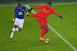LIVERPOOL, ENGLAND - Monday, December 19, 2016: Liverpool's Divock Origi has his shirt pulled by Everton's Idriss Gueye during the FA Premier League match, the 227th Merseyside Derby, at Goodison Park. (Pic by Gavin Trafford/Propaganda)