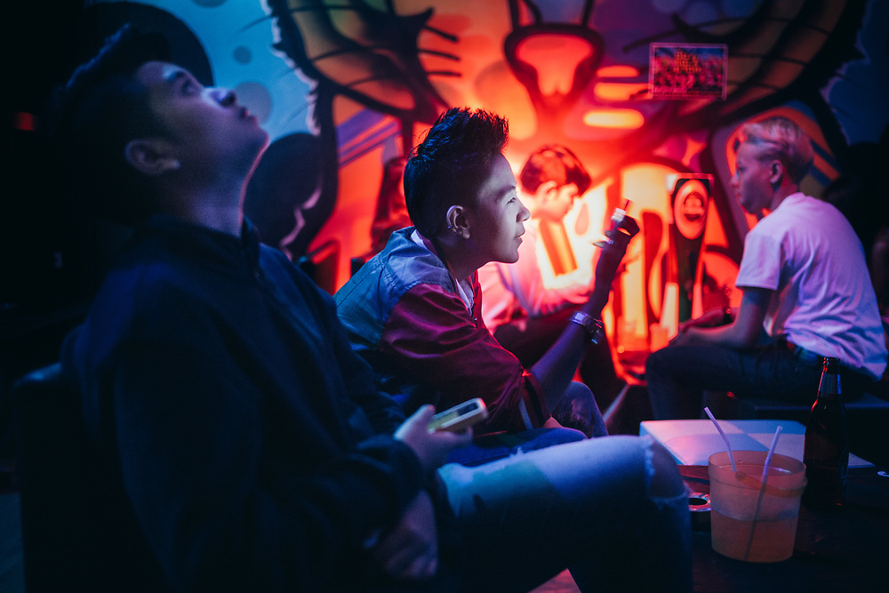 Bangkok, April 7, 2017 - Honeymoon Tomboy Club RCA<br /> TomBoy looking at her mobilphone, inside the Honeymoon Tomboy Club RCA, a popular place to meet Toms in Bangkok.Bangkok, le 7 avril 2017 - Honeymoon Tomboy Club RCA<br /> TomBoy regarde son téléphone portable, à l'intérieur du Honeymoon Tomboy Club RCA, un endroit populaire pour rencontrer Toms à Bangkok.