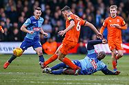 Wycombe Wanderers forward Adebayo Akinfenwa(20)flies in for a tackle on Luton Town defender Matthew Person during the EFL Sky Bet League 1 match between Luton Town and Wycombe Wanderers at Kenilworth Road, Luton, England on 9 February 2019.