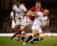 Rugby Union - 2019 pre-Rugby World Cup warm-up (Under Armour Summer Series) - Wales vs. England<br /> <br /> England's Willi Heinz is tackled by Wales' Dan Biggar, at Principality (Millennium) Stadium.<br /> <br /> COLORSPORT/ASHLEY WESTERN