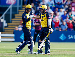 Jeremy Lawlor of Glamorgan celebrates with team-mate David Lloyd<br /> <br /> Photographer Simon King/Replay Images<br /> <br /> Vitality Blast T20 - Round 1 - Glamorgan v Somerset - Thursday 18th July 2019 - Sophia Gardens - Cardiff<br /> <br /> World Copyright © Replay Images . All rights reserved. info@replayimages.co.uk - http://replayimages.co.uk