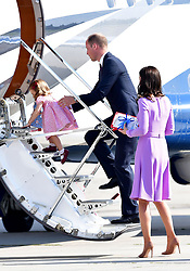The Duke and Duchess of Cambridge as board a plane in Hamburg with Princess Charlotte at the end of their visit to Germany.