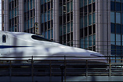 The cab of an N700 series Shinkansen (bullet train) speeding through Yurakucho, Tokyo, Japan. Thursday July 2nd 2020