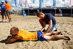 20150828 NED: NK Beachvolleybal 2015, Scheveningen<br />Kwalificaties NK Beachvolleybal 2015, injury, hamstrings