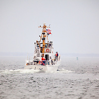"""The United States Coast Guard Auxiliary boat Lady M leaving the Coast Guard Station Sandy Hook.  The Coast Guard Auxilary was established on June 23, 1939 by an act of Congress as the United States Coast Guard Reserve and re-designated as the Auxiliary on February 19, 1941. The Auxiliary is an incorporated, civilian volunteer component of the United States Coast Guard (""""USCG"""")."""