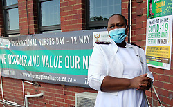 SOUTH AFRICA - Durban - 04 May 2020 - Nurses holding the caddles from L-R is Thembelihle Motsoeneng (Professional Nurse) celebrated the International Nurses Day organised on 12 May 2020 at King Edward Hospital in Umbilo, Durban in celebration of birth anniversary of Florence Nightingale.<br /> Picture: Motshwari Mofokeng/African News Agency (ANA)