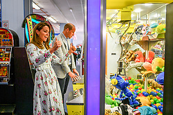 File photo dated 05/08/20 of the Duke and Duchess of Cambridge playing a grab a teddy game during their visit to Barry Island, South Wales. The Duchess of Cambridge will have spent a decade as an HRH when she and the Duke of Cambridge mark their 10th wedding anniversary on Thursday. Issue date: Wednesday April 28, 2021.