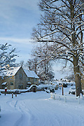 Traditional cottage during snowy weather in the village of Swinbrook, The Cotwolds