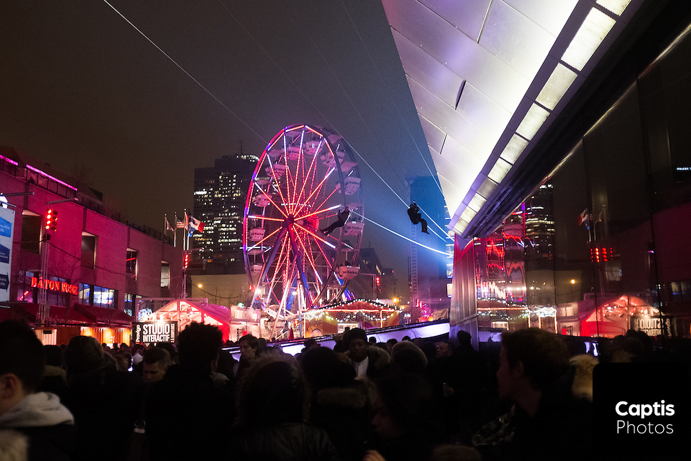 People zip line over Lumière festival celebrations in downtown Montreal. February 28, 2016 Brendan Montgomery/Captis Photos