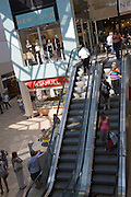 People shopping inside the Lion Yard shopping centre, Cambridge, England