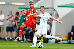 Josip Ilicic of Slovenia and Kieran Gibbs of England of Slovenia during the EURO 2016 Qualifier Group E match between Slovenia and England at SRC Stozice on June 14, 2015 in Ljubljana, Slovenia. Photo by Mario Horvat / Sportida