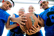 Robin Zielinski – Sun-NewsMembers of the Smokin Aces gather for a portrait in between Gus Macker games on Saturday at the Field of Dreams. Pictured from left, Isac Rodriguez, 8, Jason Misquez, 8, Joselyn Fierro, 9, and Fabian Lozoya, 9.