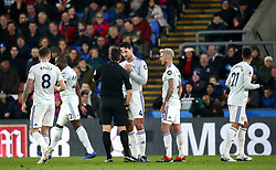 Cardiff City's Sean Morrison (centre) speaks to the Match referee Lee Probert (centre left) after Sol Bamba receives a yellow card during the Premier League match at Selhurst Park, London.