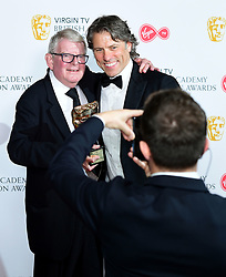 John Motson with his Bafta special award alongside John Bishop (right) in the press room at the Virgin TV British Academy Television Awards 2018 held at the Royal Festival Hall, Southbank Centre, London.