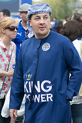 © Licensed to London News Pictures. 07/05/2016. Leicester, UK. Leicester City fans celebrating outside the King Power stadium before their match with Everton before lifting the Premiership trophy. Pictured, now typical Leicester tailoring. Photo credit: Dave Warren/LNP