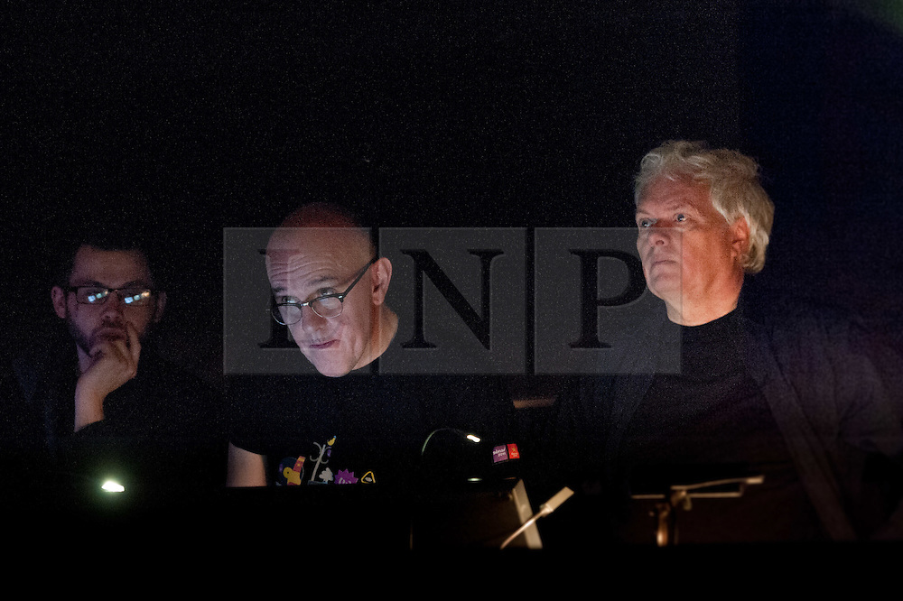 © Licensed to London News Pictures. 03/03/2012. London, UK. From the technical rehearsal for the London premier on March 3rd 2012  of Surrogate Cities by Heiner Goebbels. Featuring Trinity Laban Symphony Orchestra and performed at the Royal Festival Hall, London. Picture shows the composer directing the technical rehearsal. Photo credit : Tony Nandi/LNP