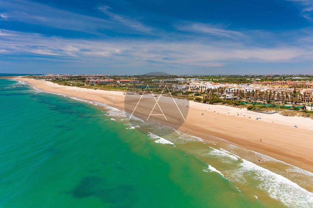 Aerial view of the beach of Playa La Ballena with a long sandy shoreline and turquoise waters in Cadiz, Andalusia, Spain.