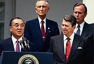 Prime Minister Yasuhiro Nakasone makes a statement in the Rose Garden of the White House on April 13, 1986,  Ambassador Mike Mansfield, VP HW Bush and President Reagan are in the photo.<br />Photo by Dennis Brack