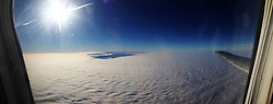 Photo from the window of the November 20th Air France AF 5483 flight from Amsterdam to Strasbourg, using the panorama feature of the camera on a iPhone5..©Michael Schofield.