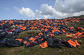 A hill of life jackets on Lesbos