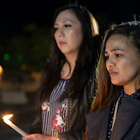 Sisters Dana Ponce (left) and Mary Frances Ponce attend a candlelight vigil at the Gallup Courthouse Square, Thursday, Sept. 27, 2018 as part of Gallup Pride 2018.