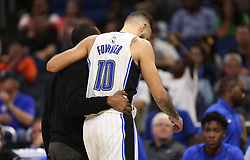 December 6, 2017 - Orlando, FL, USA - Orlando Magic forward-guard Evan Fournier (10) gets a help leaving the court after twisting his ankle during overtime play -- <br />The Orlando Magic hots the Atlanta Hawks at Amway Center, on Wednesday, December 6, 2017.<br />The Magic won the game in overtime play 110-106. (Credit Image: © Ricardo Ramirez Buxeda/TNS via ZUMA Wire)