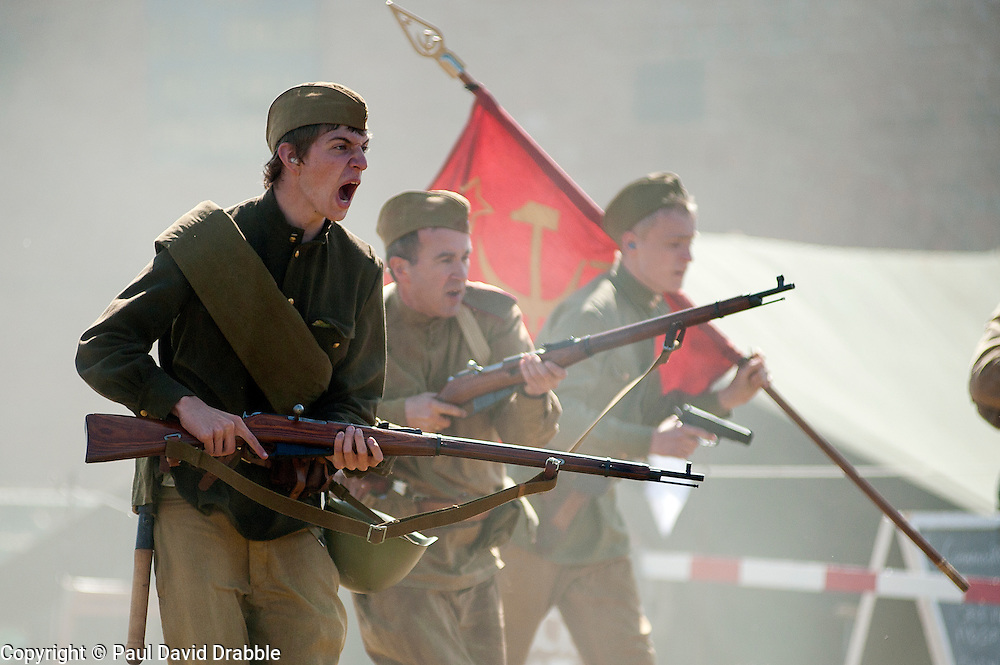 """Re-enactors portray Soviet soldiers from the Russian 13th Guards Rifle Division """"Poltavaskaya""""<br /> at Fort Paull Nr Hull May 2011<br /> Image © Paul David Drabble"""