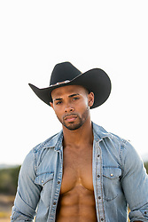 portrait of a good looking African American cowboy