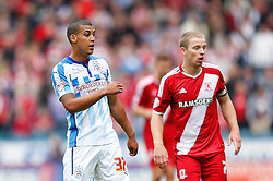 Lee Peltier of Huddersfield looks on with Grant Leadbitter of Middlesbrough - Photo mandatory by-line: Rogan Thomson/JMP - 07966 386802 - 13/09/2014 - SPORT - FOOTBALL - Huddersfield, England - The John Smith's Stadium - Huddersfield town v Middlesbrough - Sky Bet Championship.