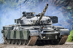 """An FV4201 Chieftain main battle tank of the United Kingdom during the 1960s, 1970s and 1980s, drives around the tank course at the Tank Museum in Bovington, Dorset, as the attraction hosts """"Tiger Day"""" to mark the 75th anniversary of the world's only working Tiger Tank's capture in 1943 in the Tunisian desert."""