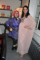 Left to right, ZANDRA RHODES and CARMEN HAID at a dinner hosted by Carmen Haid at Atelier Mayer, 47 Kendal Street, London W2 on 21st February 2012.