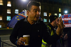 "A pro-Brexit campaigner argues with members of the public and pro-remain campaigners after they disembark from a bus emblazoned with ""Bollox to Brexit"" as it arrives at Steve Bray's ongoing pro-remain protest at Old Palace Yard outside Parliament. Westminster, London, December 20 2018."