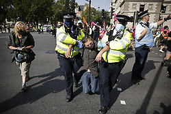 © Licensed to London News Pictures. 02/09/2020. London, UK. Police remove Extinction Rebellion protesters from the road in Whitehall. A second day of protests is taking place in central London. Photo credit: Peter Macdiarmid/LNP