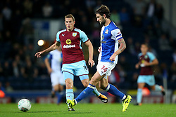 Charlie Mulgrew of Blackburn Rovers and Burnley's Chris Wood - Mandatory by-line: Matt McNulty/JMP - 23/08/2017 - FOOTBALL - Ewood Park - Blackburn, England - Blackburn Rovers v Burnley - Carabao Cup - Second Round