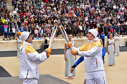 October 31, 2017 - Athens, Attiki, Greece - Last Torchbearer Ioannis Proios (right) is given the Olympic Flame by Kim Ki-hoon (left), second to last Torchbearer. The Handover Ceremony of the Olympic Flame for Winter Games PYEONGCHANG 2018, took place today in Panathenaic Stadium in the presence of the President of Hellenic Republic Prokopis Pavlopoulos. (Credit Image: © Dimitrios Karvountzis/Pacific Press via ZUMA Wire)