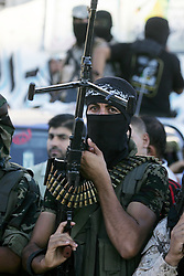 September 26, 2016 - Rafah, Gaza Strip, Palestinian Territory - Palestinian militants from the Al-Nasser Brigades, an armed wing of the Popular Resistance Committees (PRC), hold their weapons during a rally in Rafah in the southern Gaza Strip on September 26, 2016, to mark the 17th anniversary of the creation of their group  (Credit Image: © Abed Rahim Khatib/APA Images via ZUMA Wire)