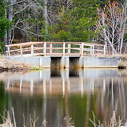 A Bridge Reflects Off Of A Still Pond At Seney National Wildlife Refuge