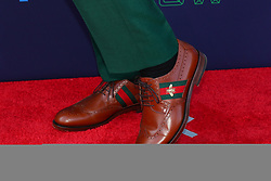 April 26, 2018 - Arlington, TX, U.S. - ARLINGTON, TX - APRIL 26:  Lamar Jackson shows his Gucci shoes on the Red Carpet prior to the 2018 NFL Draft at AT&T Statium on April 26, 2018 at AT&T Stadium in Arlington Texas.  (Photo by Rich Graessle/Icon Sportswire) (Credit Image: © Rich Graessle/Icon SMI via ZUMA Press)