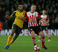Football - 2016 / 2017 FA Cup - Fourth Round: Southampton vs. Arsenal<br /> <br /> Theo Walcott of Arsenal and Southampton's Jordy Clasie go shoulder to shoulder trying to win the ball at St Mary's Stadium Southampton England<br /> <br /> COLORSPORTt/SHAUN BOGGUST