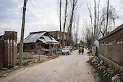 Roads and homes wait to be repaired after the devastating floods that decimated Narbal village, Jammu and Kashmir, India, on 24th March 2015. Nearly 2500 villagers including Srinagar, the capital of the state of Jammu and Kashmir, was devastated by severe floods and landslides in September 2014 the worst in 60 years, displacing millions of people, many of them children. Photo by Suzanne Lee for Save the Children
