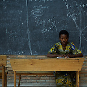 A member of the Burundian National Independent Electoral Commission awaits the closing of the votes for the parliamentary elections at a polling station in Cibitoke neighbourhood, Bujumbura, June 29, 2015.