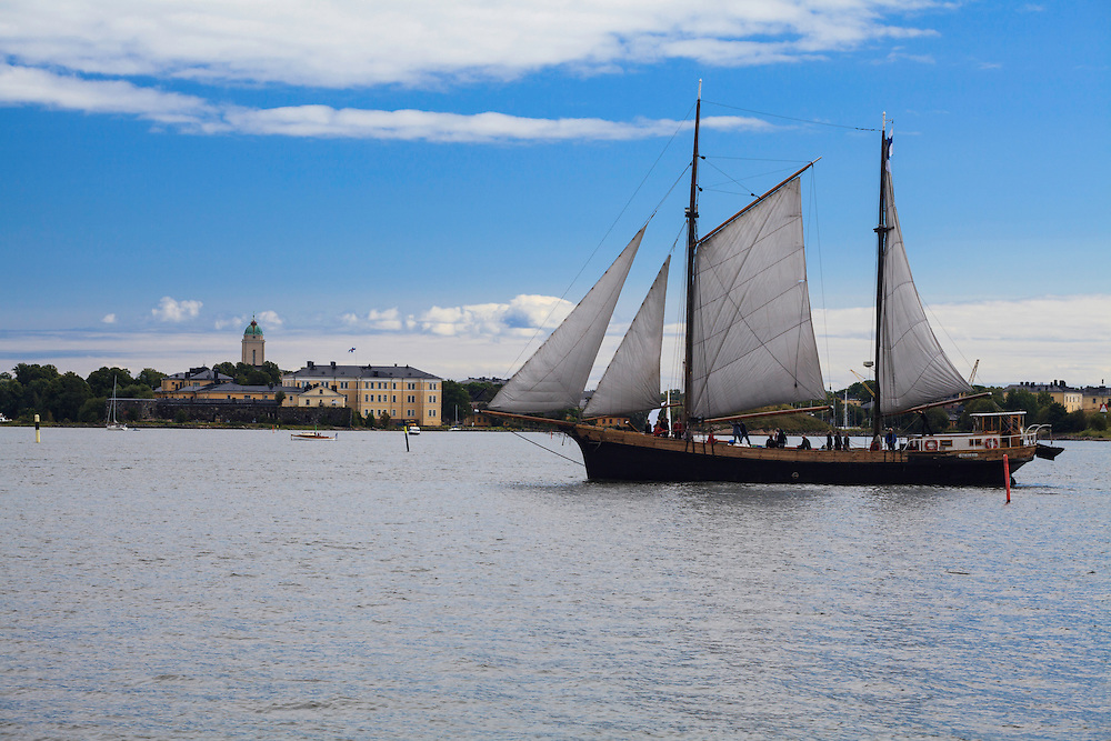 The galeas Inga-Lill in front of Suomenlinna sea fortress Helsinki, Finland. A former cargo ship offers today an unsurpassed cruising experience with gourmet menus on board.