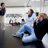 NATIONAL THEATRE OF SCOTLAND & TRAVERSE THEATRE.EDINBURGH'S FESTIVAL FRINGE 2011..Picture shows : Rehearsals for 'The Wheel' - director  Vicky Featherstone (l), Catherine Walsh and Ryan Fletcher. World Premiere - The Wheel .Written by Zinnie Harris, Directed by Vicky Featherstone opens at the Traverse Theatre, Edinburgh: Thu 28 July - Sun 28 Aug,   (Traverse 1 Fringe Venue: 15 ). Picture by Drew Farrell. Tel 07721-735041..Beatriz and her sister Rosa are happily preparing for Rosa's wedding. Their world is turned upside down when the groom arrives, pitchfork rabble in tow, ready to occupy their farm.  A little girl stumbles into their world, lost and looking for her father. In a moment of determination Beatriz takes the girl to find him - and so begins an unimaginable journey.  Beatriz and her charge, in their need to survive, witness more than anyone ever should..For further information NTS Press contact Andrew Neilson .E: andrew.neilson@nationaltheatrescotland.com.T:+44(0)141 227 9497 M:+44(0)7912 540 139.