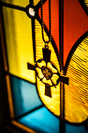 A pectoral cross with the Luther rose hangs in front of a stained glass window on Saturday, Jan. 16, 2021, at Zion Lutheran Church, Fort Wayne, Indiana. LCMS Communications/Erik M. Lunsford